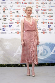 Amber Heard looked sweet and chic in a pink cowl-neck cami by Cloe Cassandro at the 2019 Giffoni Film Festival.