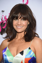 Carla Gugino attended the Broadway opening of 'Gigi' wearing a fab wavy 'do with eye-skimming bangs.