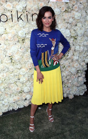 Camilla Belle went for a bold color pairing with this lemon-yellow skirt and blue sweater combo by Ralph Lauren.