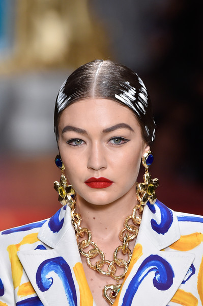 Gigi Hadid Dangle Decorative Earrings [hair,eyebrow,beauty,hairstyle,fashion,lip,hair accessory,headpiece,jewellery,fashion accessory,gigi hadid,moschino - runway,runway,milan,italy,moschino,milan fashion week,show,milan fashion week spring]