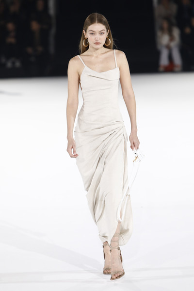 Gigi Hadid Sundress [fashion model,fashion show,fashion,runway,white,clothing,dress,shoulder,beauty,fashion design,gigi hadid,jacquemus,runway - paris fashion week,part,runway,paris,france,jacquemus menswear fall,paris fashion week,show,gigi hadid,paris fashion week,chanel,fashion,fashion week,vogue,fashion show,runway,model]