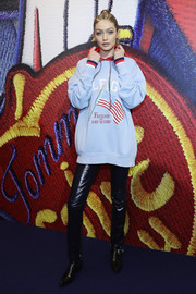 Gigi Hadid was casual and comfy in an oversized flag print sweatshirt while presenting the Tommy x Gigi capsule collection.