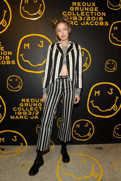 Gigi Hadid Pantsuit [the marc jacobs redux grunge collection,yellow,font,style,marc jacobs,sofia coppola,katie grand celebrate the marc jacobs redux grunge collection and the opening of marc jacobs madison,katie grand,gigi hadid,marc jacobs madison,new york city,opening]