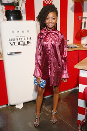 Skai Jackson looked groovy in a metallic pink pussybow shirtdress by Greta Constantine at the Vogue Eyewear #ShowYourParty event.