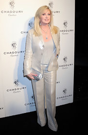 Morgan Fairchild achieved effortless elegance with her iridescent pantsuit at the Chagoury Couture debut.
