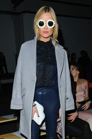 Laura Whitmore flirted with a white Lulu Guinness lips clutch during London Fashion Week.