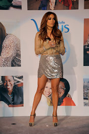 Jennifer Lopez dazzled at a Gillette Venus event in nude Boulima d'Orsay pumps with chain mail cap toes.
