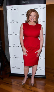 Caroline Manzon chose a vibrant red, peplum dress for her look at the 'Let Me Tell You Something' book launch.