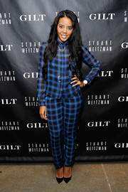 Angela Simmons sported the pajama look with a pair of plaid pants and a matching top during the 5050 boot anniversary.