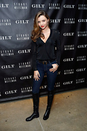 Miranda Kerr was casual yet stylish in black knee-high boots, jeans, and a long-sleeve top during the 5050 boot anniversary.