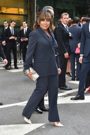 Tina Turner added a bit of shine with a metallic silver clutch.