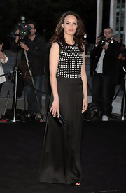 Berenice Bejo wore a column-style dress with a black-and-white checked bodice and a flowing black satin skirt.
