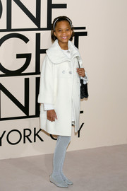 Quvenzhane Wallis arrived at the Giorgio Armani SuperPier show wearing a white wool coat over her dress.