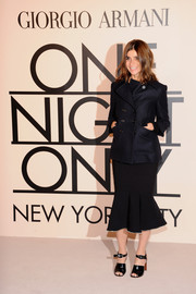 Carine Roitfeld completed her outfit with a pair of chunky-heeled black patent sandals.