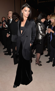 Crystal Renn looked dramatic at the Giorgio Armani SuperPier show in a black evening coat teamed with a bandeau top and a long velvet skirt.