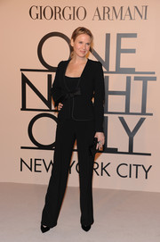 Renee Zellweger looked classic in a black Armani pantsuit during the Giorgio Armani SuperPier show.