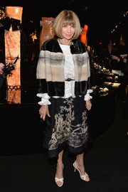 Anna Wintour was head-to-toe luxe in a color-blocked fur coat and an embroidered skirt during the Giorgio Armani SuperPier show.