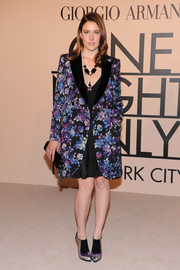 Greta Gerwig donned a stylish flowery coat for the Giorgio Armani SuperPier show.