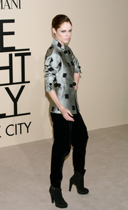 A pair of black ankle boots added an edge to Coco Rocha's look during the Giorgio Armani SuperPier show.