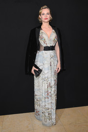 Diane Kruger cut an ultra-sophisticated figure in an Oriental-inspired print gown with sheer sides at the Armani Prive fashion show.