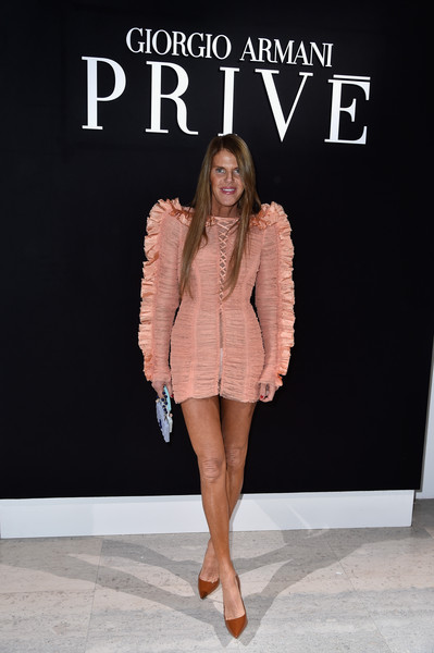 Anna dello Russo opted for simple tan pumps to pair with her flirty dress.