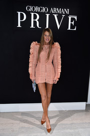 Anna dello Russo was hard to miss in this ruched and ruffled pink mini dress by Roberto Cavalli at the Armani Prive fashion show.