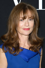 Bangs and curled ends gave Isabelle Huppert a timeless look.