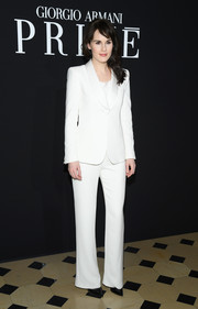 Michelle Dockery suited up in all white for the Armani Prive fashion show.