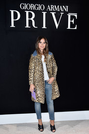 Miroslava Duma walked on the wild side in a leopard-print leather coat with a blue fur collar during the Armani Prive fashion show.