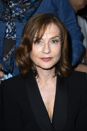 Isabelle Huppert sported neat curls and side-swept bangs at the Armani Prive fashion show.