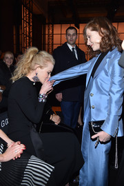 Isabelle Huppert arrived for the Armani Prive fashion show carrying a black patent bag with a silver chain strap.