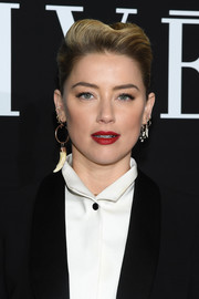 Amber Heard rocked a sculpted pompadour at the Armani Prive fashion show.
