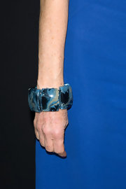 Isabelle Huppert accessorized with a chunky cuff bracelet at the Armani Prive fashion show.