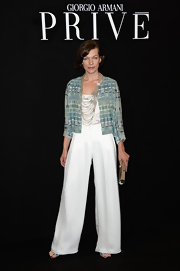 Milla Jovovich rocked a teal beaded geometric fitted jacket over a basic white top and wide-leg white pants.