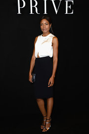 Naomie chose a knee-length black pencil skirt for a simple and classic look at the Giorgio Armani Prive Haute Couture.