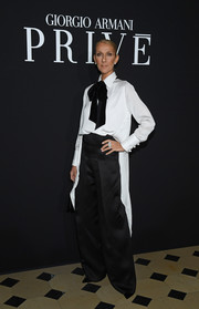 Celine Dion went menswear-chic in a white high-low blouse with a black pussy bow at the Armani Prive fashion show.