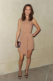 Eva Amurri paired her chic neutral colored draped frock with strappy black heels.
