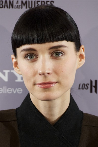 Rooney Mara attended the Madrid premiere of 'The Girl with the Dragon Tattoo' wearing a ponytail with blunt bangs.