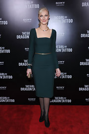 Joely Richardson wore a bronze belt with her emerald dress for the 'Girl With the Dragon Tattoo' premiere.