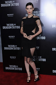Rooney Mara's seductive gothic style was perfectly captured in her Prabal Gurung dress for the Girl With the Dragon Tattoo New York premiere. The raven haired actress' black cutout dress with airy sheer insets was like the mischievous version of her Givenchy Couture premiere dress.