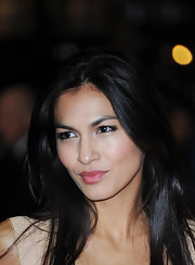 Elodie Yung wore a lovely rosy pink lipstick with a hint of frosty shine at the world premiere of 'The Girl With The Dragon Tattoo.'