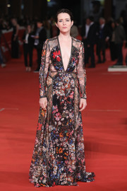 Claire Foy looked sensational in a flowing floral lace gown by Elie Saab at the Rome Film Fest screening of 'The Girl in the Spider's Web.'
