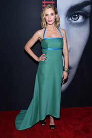 Emily Blunt captivated in a custom Prada fishtail gown, in green with blue satin trim, during the New York premiere of 'The Girl on the Train.'