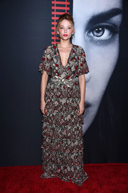 Haley Bennett chose an Altuzarra snakeskin-print gown, featuring a plunging neckline, a tiered skirt, and red beading, for the New York premiere of 'The Girl on the Train.'