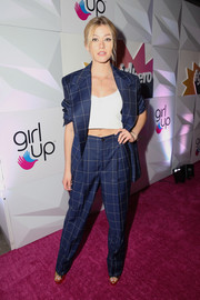 Katherine McNamara kept it classic in a navy grid-print pantsuit by Ralph Lauren at the #girlhero Awards luncheon.