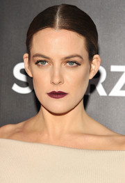 Riley Keough rocked dark red lipstick for a sexy-edgy beauty look.