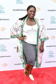 Underneath her coat, Danielle Brooks kept it relaxed in a gray pencil skirt and a white shirt.
