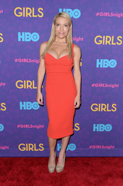 Tracy Anderson flaunted her assets in a low-cut coral dress during the 'Girls' season 3 premiere.