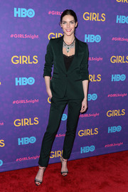 A pair of black and silver ankle-strap sandals added a feminine touch to Hilary Rhoda's menswear-inspired look.