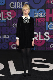 Erin Fetherston looked twee at the 'Girls' season 4 premiere in a short black shirtdress with a contrasting white collar and cuffs and a plaid ascot tie.